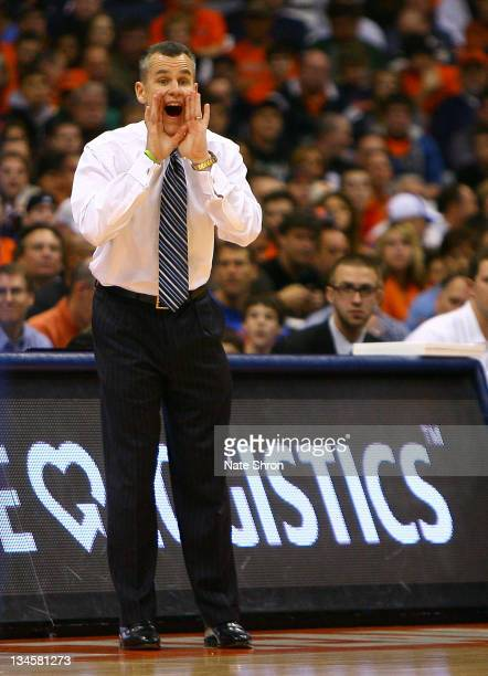 Head coach Billy Donovan of the Florida Gators yells to players from the sideline during the game against the Syracuse Orange at the Carrier Dome on...