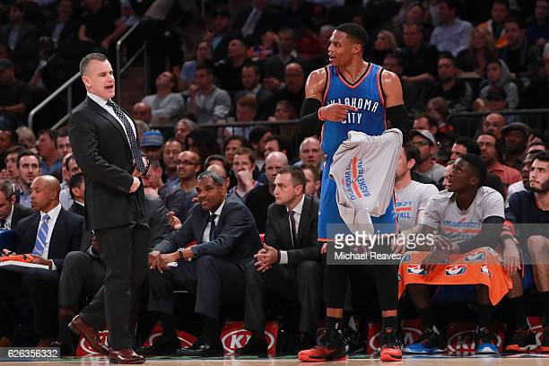 Head coach Billy Donovan of the Oklahoma City Thunder and Russell Westbrook react against the New York Knicks during the second half at Madison...
