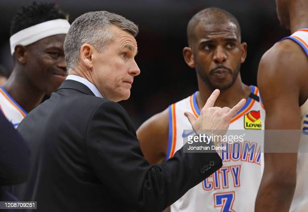 Head coach Billy Donovan of the Oklahoma City Thunder talks to his players, including Luguentz Dort and Chris Paul during a time against the Chicago...