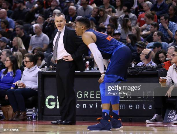 Head Coach Billy Donovan of the Oklahoma City Thunder talks to Russell Westbrook during the second half of an NBA game against the Toronto Raptors at...