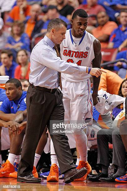 Head coach Billy Donovan talks to Casey Prather of the Florida Gators during second half action against the Fresno State Bulldogs during the MetroPCS...