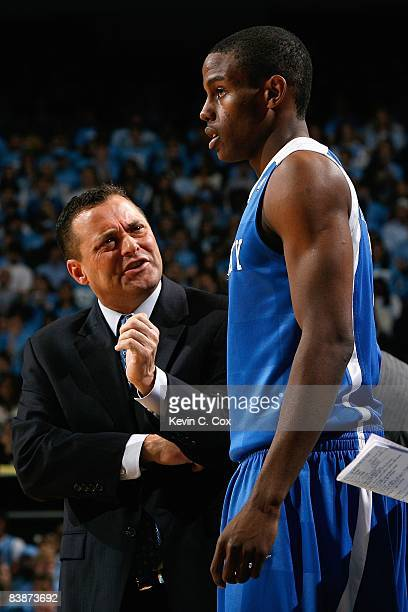 Head coach Billy Gillispie of the Kentucky Wildcats speaks with Darius Miller during the game against the North Carolina Tar Heels at the Dean E...