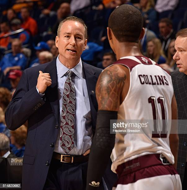 Head coach Billy Kennedy coaches Anthony Collins of the Texas AM Aggies during the first half of an SEC Tournament Quarterfinal game against Florida...
