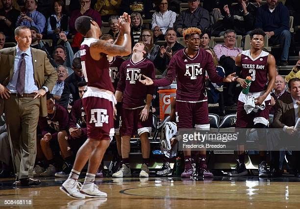Head coach Billy Kennedy of the Texas AM Aggies and his bench reacts during the final moments of the second half of a 7760 Vanderbilt upset of Texas...