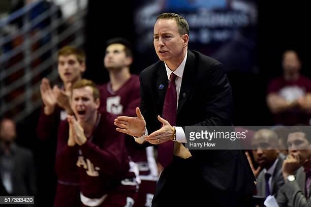 Head coach Billy Kennedy of the Texas AM Aggies cheers on his team in the second half while taking on the Oklahoma Sooners in the 2016 NCAA Men's...