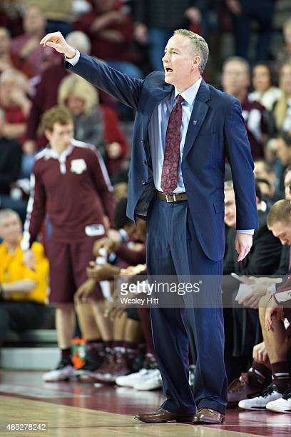 Head Coach Billy Kennedy of the Texas AM Aggies signals to his team during a game against the Arkansas Razorbacks at Bud Walton Arena on February 24...