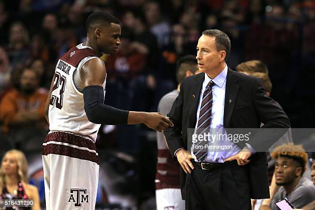 Head coach Billy Kennedy of the Texas AM Aggies talks with Danuel House in the second half against the Green Bay Phoenix during the first round of...