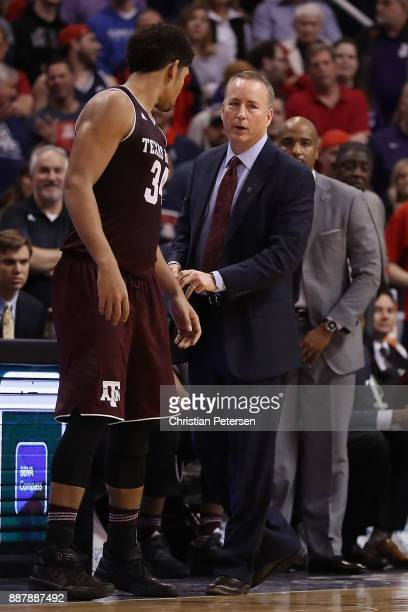 Head coach Billy Kennedy of the Texas AM Aggies talks with Tyler Davis during the college basketball game against the Arizona Wildcats at Talking...