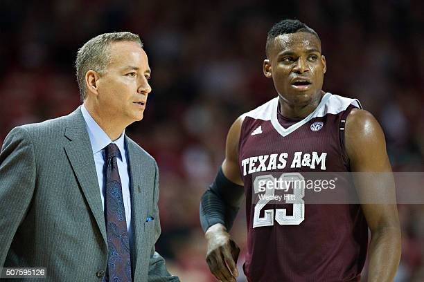 Head Coach Billy Kennedy talks with Danuel House of the Texas AM Aggies during a game against the Arkansas Razorbacks at Bud Walton Arena on January...