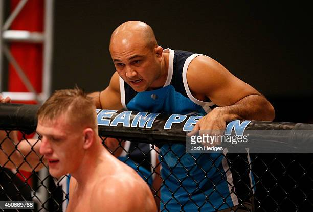 Head Coach BJ Penn gives advice to team Penn fighter Anton Berzin in between rounds against team Edgar fighter Patrick Walsh in their preliminary...