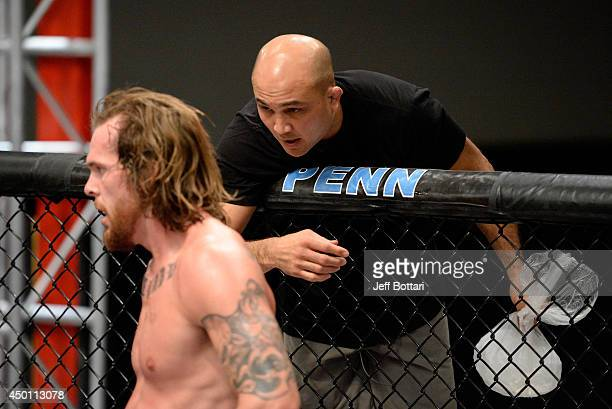 Head Coach BJ Penn gives advice to team Penn fighter Mike King while facing team Edgar fighter Eddie Gordon in their preliminary fight during filming...