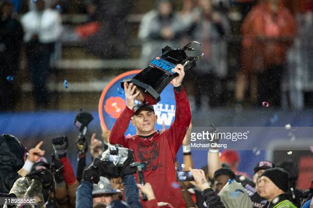Head coach Blake Anderson of the Arkansas State Red Wolves holds up the Camellia Bowl trophy after defeating the FIU Golden Panthers in the Camellia...