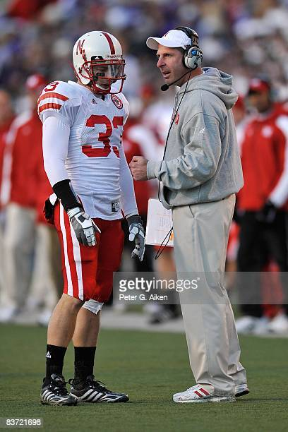 Head coach Bo Pelini of the Nebraska Cornhuskers talks with safety Matt O'Hanlon during a time out against the Kansas State Wildcats in the third...