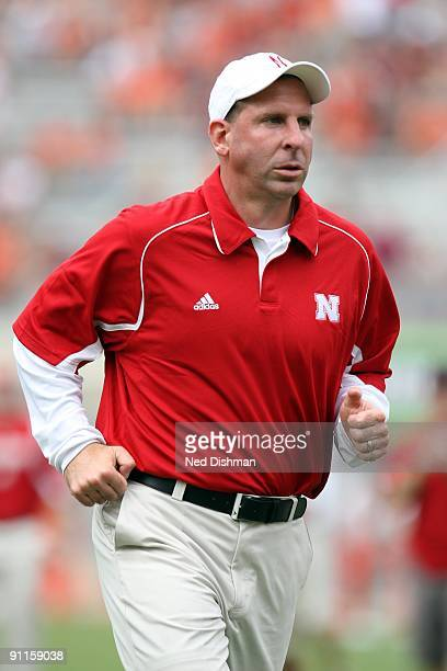 Head coach Bo Pelini of the University of Nebraska Cornhuskers runs on the sideline against the Virginia Tech University Hokies on September 19 2009...