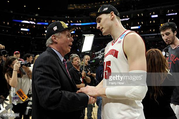 Head coach Bo Ryan and Sam Dekker of the Wisconsin Badgers celebrate after the Badgers 8578 victory against the Arizona Wildcats during the West...