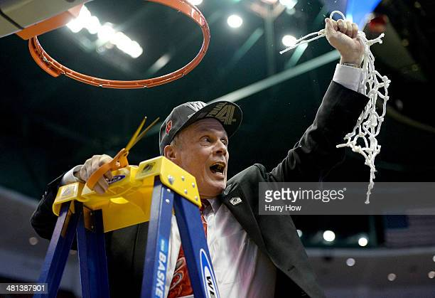 Head coach Bo Ryan of the Wisconsin Badgers celebrates after he cuts down the net after defeating the Arizona Wildcats 6463 in overtime during the...