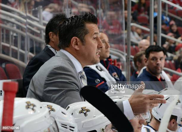 Head coach Bob Boughner of the Florida Panthers talks with players on the bench during first period action against the Arizona Coyotes at Gila River...