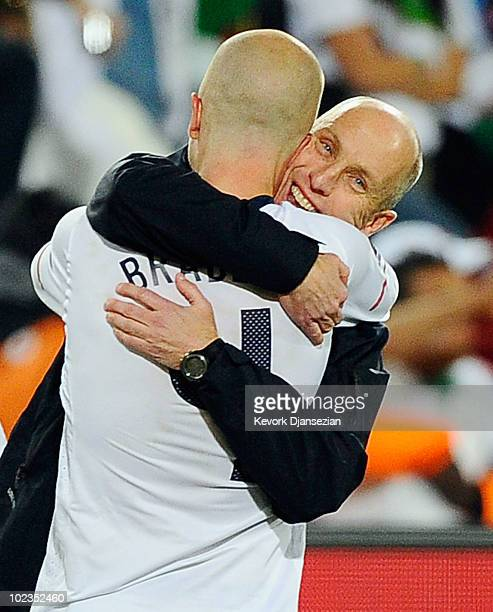 Head coach Bob Bradley hugs his son Michael Bradley after USA defeated Algeria 10 during the 2010 FIFA World Cup South Africa Group C match between...