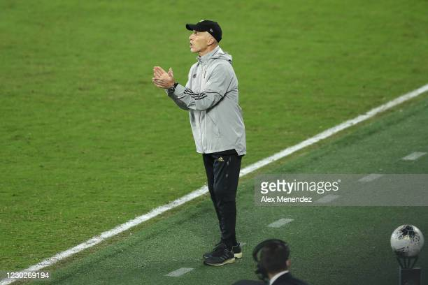 Head coach Bob Bradley of Los Angeles FC claps during the CONCACAF Champions League final game against Tigres UANL at Exploria Stadium on December...