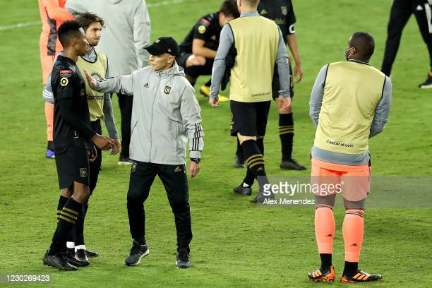 Head coach Bob Bradley of Los Angeles FC consoles players after losing the CONCACAF Champions League final game against Tigres UANL at Exploria...