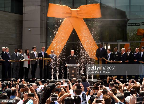 Head coach Bob Bradley of the Los Angeles FC leads owners and city officials in the ribbon cutting to unveil the new stateoftheart Banc of California...