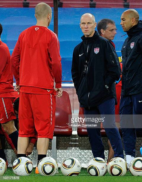 Head coach Bob Bradley of USA looks at his son Michael during training session at Ellis Park on June 17 2010 in Johannesburg South Africa USA will...