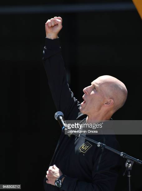 Head coach Bob Bradly of the Los Angeles FC cheers with fans during the ribbon cutting ceremony for the new Banc of California Stadium on April 18...