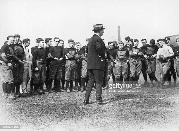 Head coach Bob Fisher addresses Harvard football candidates on the first day of spring practice Boston Massachusetts April 28 1925