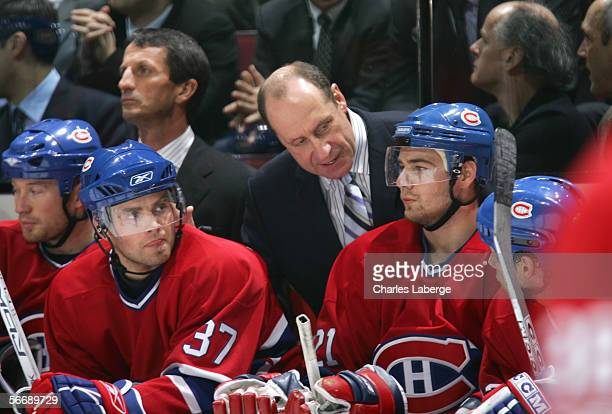 Head coach Bob Gainey of the Montreal Canadiens looks in on Chris Higgins during the game against the Dallas Stars at the Bell Centre on January 16...