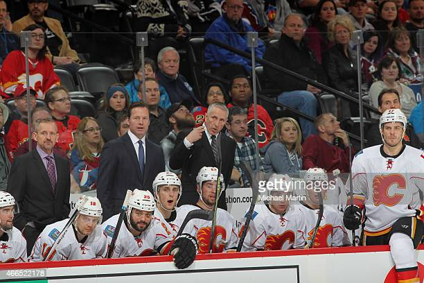 Head coach Bob Hartley of of the Calgary Flames leads his team against the Colorado Avalanche at the Pepsi Center on March 14 2015 in Denver Colorado...
