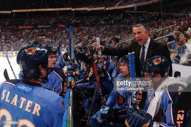 Head Coach Bob Hartley of the Atlanta Thrashers gives instructions to the team during the game against the Washington Capitals at Philips Arena on...