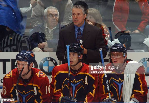 Head Coach Bob Hartley of the Atlanta Thrashers looks on from the bench area during their NHL game against the Washington Capitals on December 22...