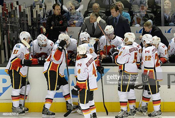 Head Coach Bob Hartley of the Calgary Flames draws up a play for his team late in the third period against the San Jose Sharks at SAP Center on...