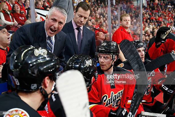 Head coach Bob Hartley of the Calgary Flames gives instructions to his players during a stoppage in play against the Vancouver Canucks at Scotiabank...