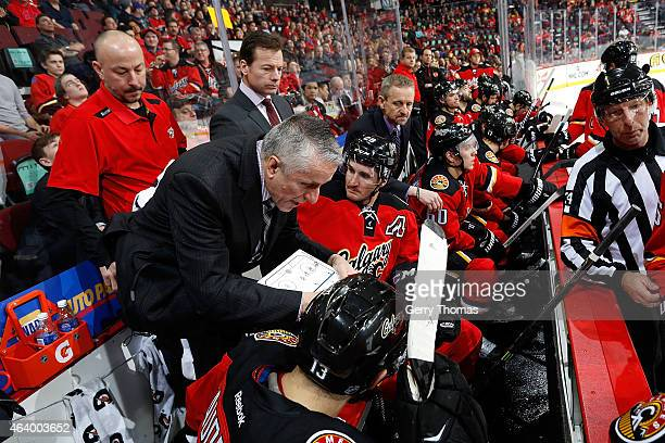 Head coach Bob Hartley of the Calgary Flames gives instructions to his players during a timeout against the Anaheim Ducks at Scotiabank Saddledome on...