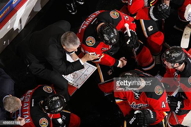 Head Coach Bob Hartley of the Calgary Flames instructs his players during a stoppage in play against the Edmonton Oilers at Scotiabank Saddledome on...