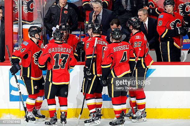 Head coach Bob Hartley of the Calgary Flames instructs his players during a timeout against the Anaheim Ducks at Scotiabank Saddledome for Game Three...