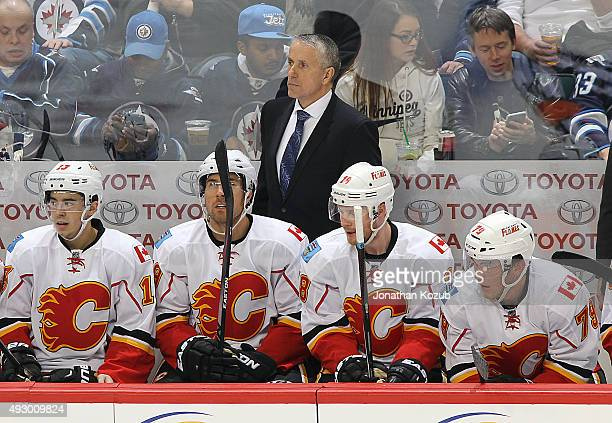 Head Coach Bob Hartley of the Calgary Flames keeps an eye on the play from the bench during second period action against the Winnipeg Jets at the MTS...