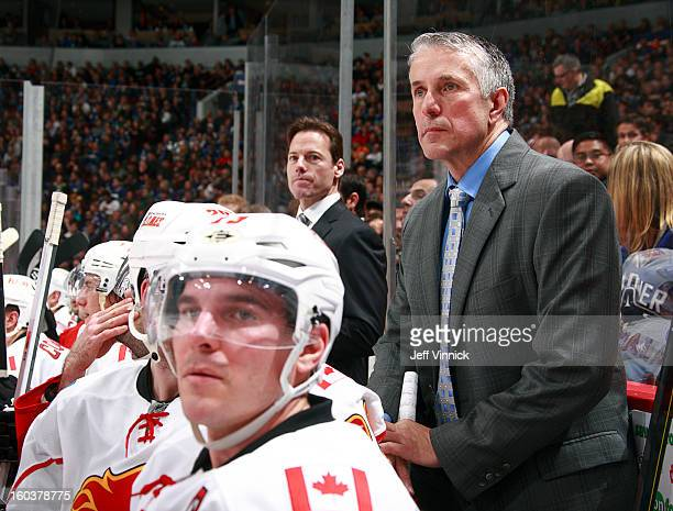 Head coach Bob Hartley of the Calgary Flames looks on from the bench during their NHL game against the Vancouver Canucks at Rogers Arena January 23...