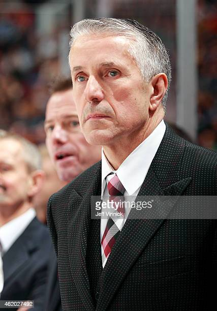 Head coach Bob Hartley of the Calgary Flames looks on from the bench during their NHL game against the Vancouver Canucks at Rogers Arena January 10...