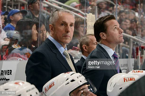 Head coach Bob Hartley of the Calgary Flames looks on from the bench during third period action against the Arizona Coyotes at Gila River Arena on...