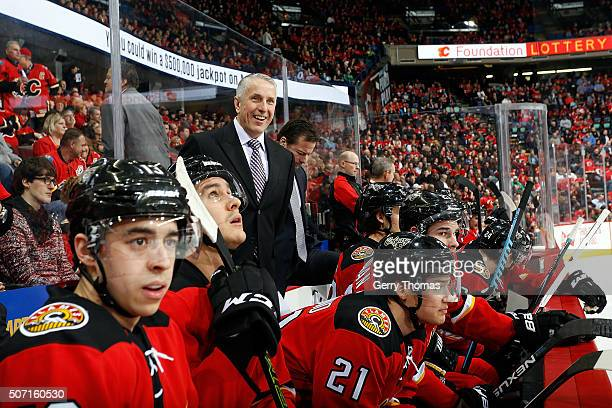 Head coach Bob Hartley of the Calgary Flames stands on the bench during an NHL game against the Nashville Predators at Scotiabank Saddledome on...