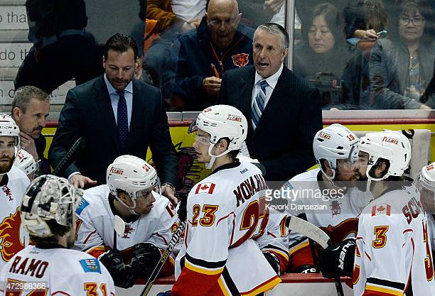Head coach Bob Hartley of the Calgary Flames talk to his players during the overtime period against Anaheim Ducks in Game Five of the Western...