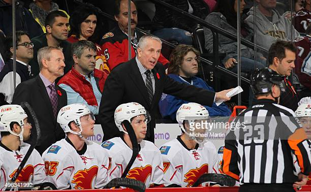 Head coach Bob Hartley of the Calgary Flames talks to an official during the game against the Colorado Avalanche at the Pepsi Center on November 3...