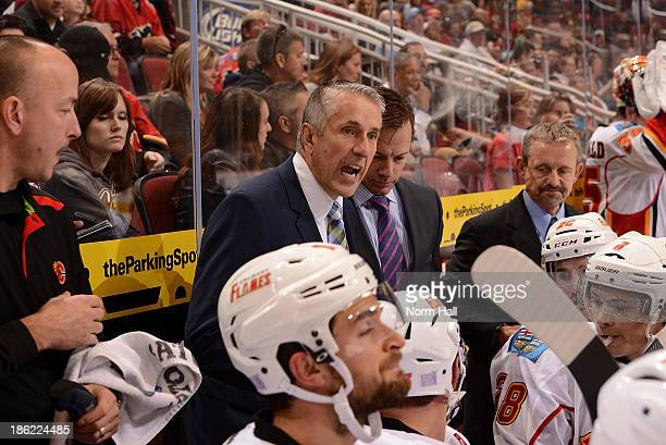 Head coach Bob Hartley of the Calgary Flames talks to his team during a timeout against the Phoenix Coyotes during the third period at Jobingcom...