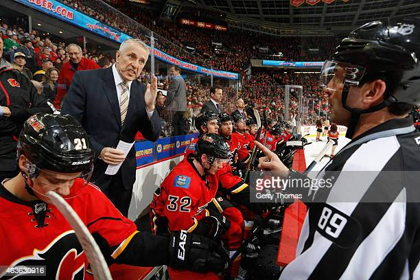 Head coach Bob Hartley of the Calgary Flames talks to officials between plays against the Boston Bruins at Scotiabank Saddledome on February 16 2015...