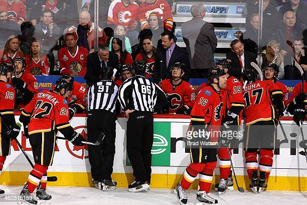 Head Coach Bob Hartley of the Calgary Flames talks to the officials in a game against the Chicago Blackhawks at Scotiabank Saddledome on November 27...