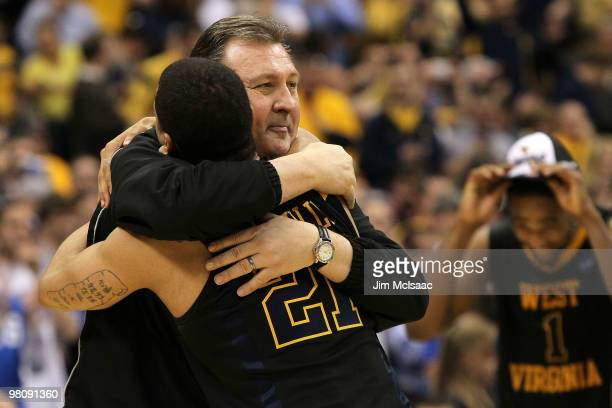 Head coach Bob Huggins and Joe Mazzulla of the West Virginia Mountaineers celebrate after they won 7366 against the Kentucky Wildcats during the east...