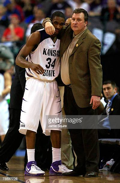 Head coach Bob Huggins of the Kansas State Wildcats hugs Akeem Wright during the quarterfinal game of the Phillips 66 Big 12 Men's Basketball...