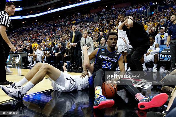 Head coach Bob Huggins of the West Virginia Mountaineers reacts as a foul is called after Xavier Ford of the Buffalo Bulls and Nathan Adrian of the...